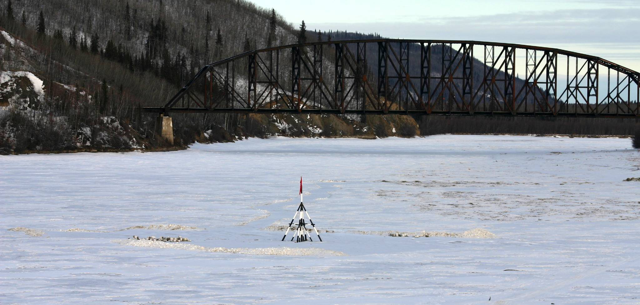 The highway crosses the Tanana River near the tiny town of Nenana, home to the Nenana Ice Classic. Every year a state-wide contest is held to see who can guess the moment the ice breaks for the spring. The winner gets thousands; in 2010, the grand prize was $279,030. (Wikimedia Commons)