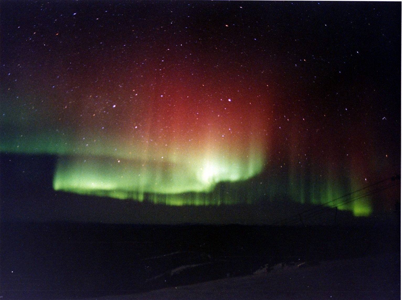 The Northern Lights in a blazing red above Fairbanks