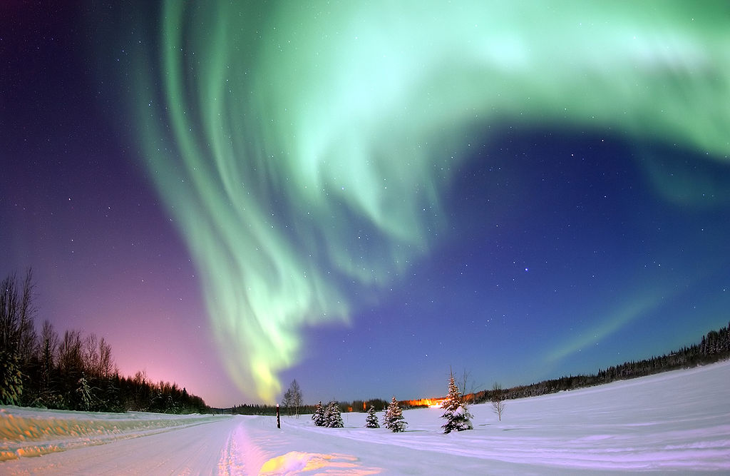 A teal display of Aurora swirls above Eielson Air Force Base outside Fairbanks