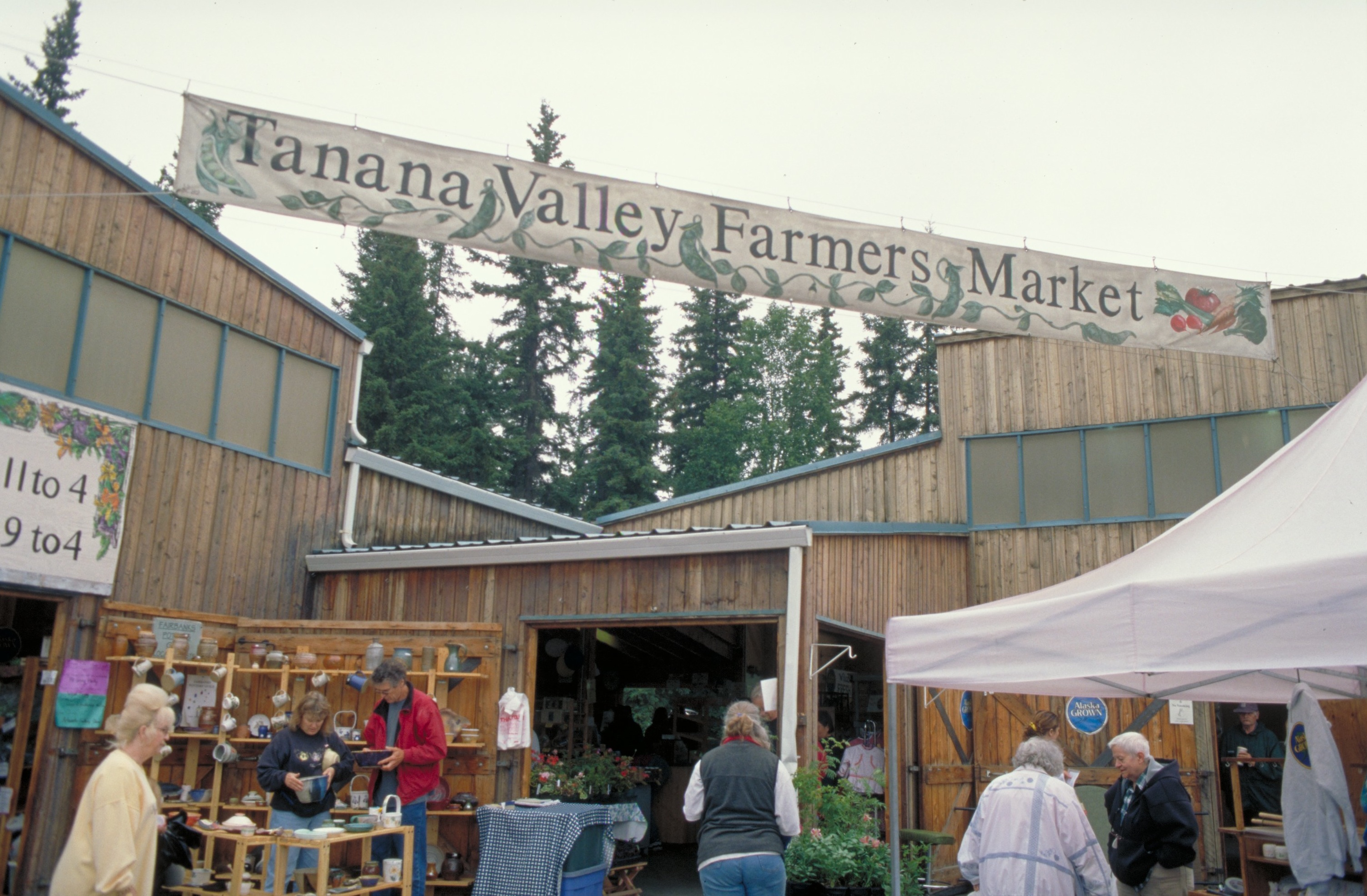 Tanana Valley Farmers Market hangs over tents and tables with local vendors