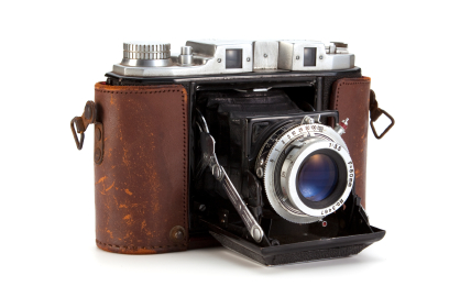 retro camera with leather look and lens door open