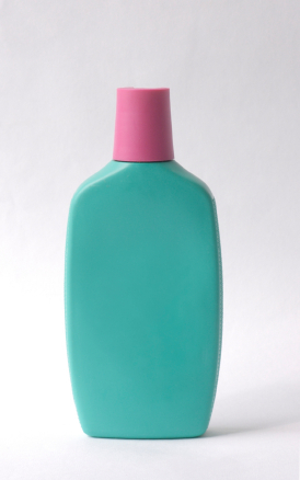 teal bottle with pink lid and no label resembling older sunscreen bottles