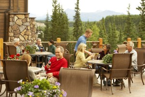guests dine on the deck of Denali Princess Wilderness Lodge