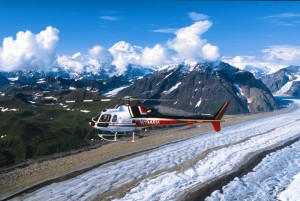 A helicopter flies over glaciers