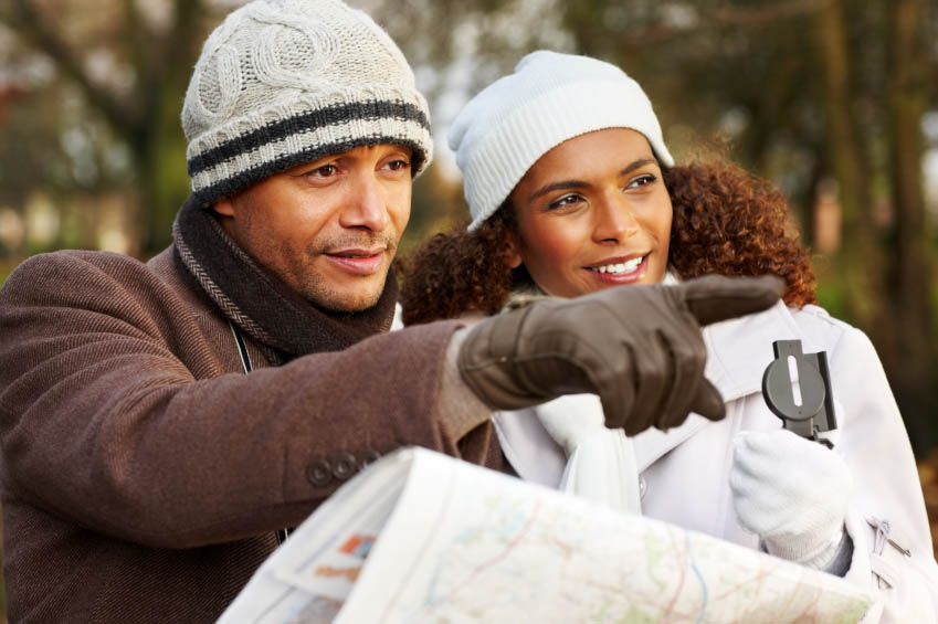 Smiling couple with map looking for directions