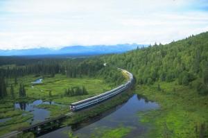 Princess railcars pass a pond in Alaska