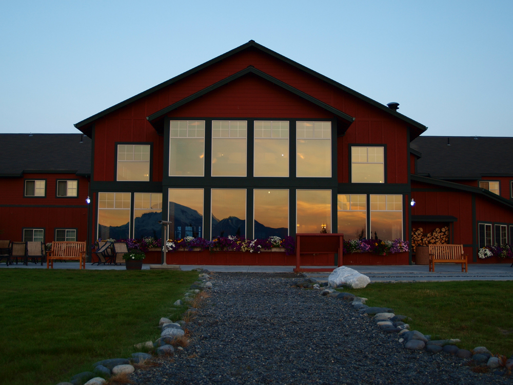 Majestic Copper River Princess Lodge with sunset mountain reflected in windows- Princess Lodges