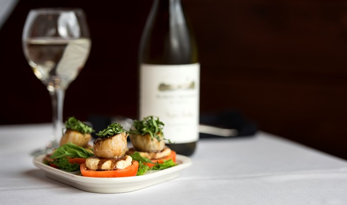 wine and scallops entree at Princess Lodges