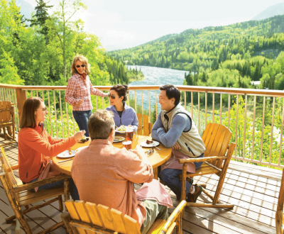 Guests gather on the deck at Kenai Princess Lodge.