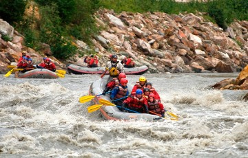 Nenana River Paddle Rafting - people enjoying white water in a raft with oars