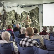 Naturalist giving a presentation in Hudson Theater at Mt. McKinley Princess Wilderness Lodge