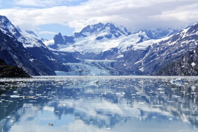 Alaska is Glacier Heaven - towering mountains with a glacier at their foot leading into a bay dotted with ice