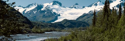 Alaskan River with snowy mountains in the background