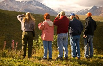Alaska Tourists Taking Pictures of the Mountain with Tour Guide