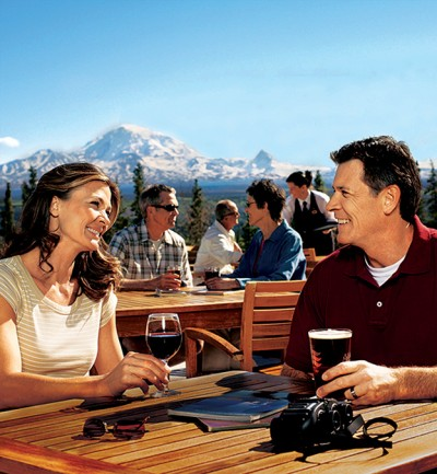 Couple enjoying happy hour on the patio at the Copper River Wilderness Lodge