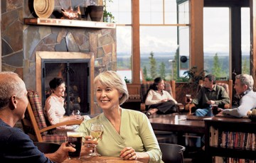 Couple enjoying wine in the Wrangell Room at the Copper River Princess Wilderness Lodge