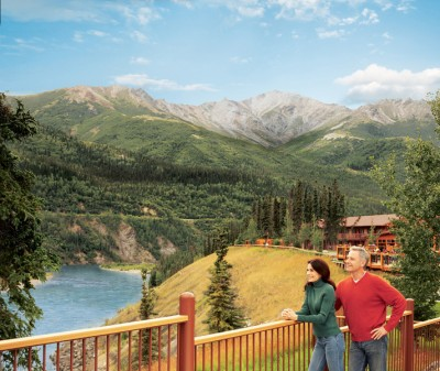 Couple overlooking the river from the deck at Denali Princess Wilderness Lodge
