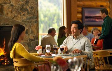 Couple dining at Eagles Crest Restaurant at the Kenai Princess Lodge in Alaska