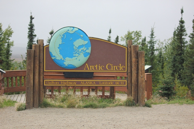 A sign welcomes visitors to the Arctic Circle