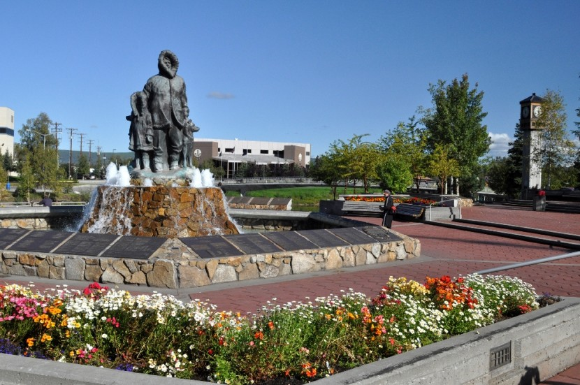 Statue of Alaska Natives with Flowers on sunny day in downtown Fairbanks, Alaska