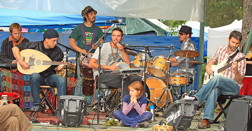 A group of musicians performs on stage