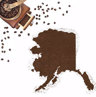 Coffee grounds in the shape of the state of Alaska