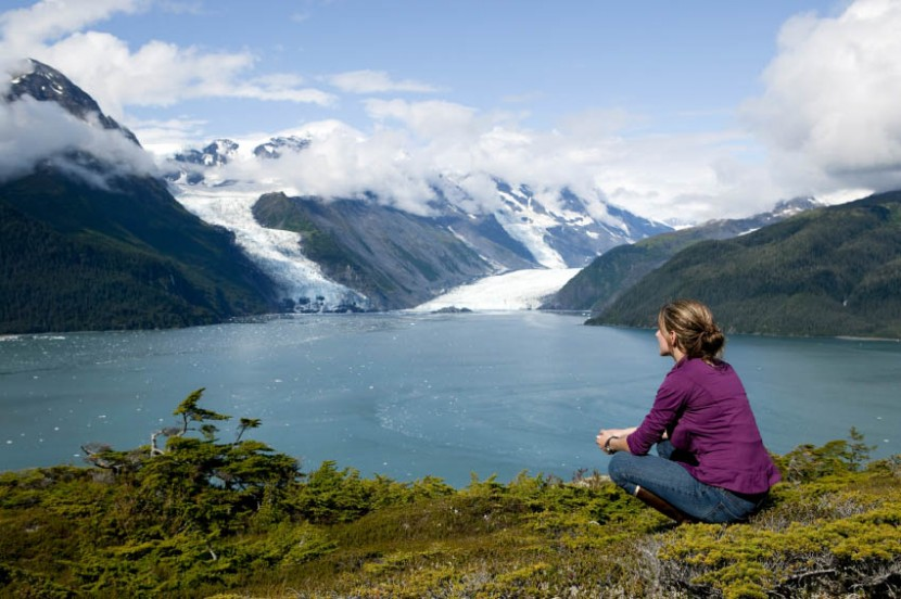 one woman sitting and thinking in prince william sound alaska overlooking columbia glacier
