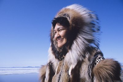 A Native Alaskan in cold weather dress.