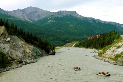 Two rafts float on the Nenana River