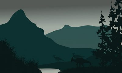 An illustration of dinosaurs in front of mountains