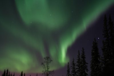 The glowing green sky of the aurora borealis