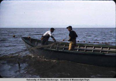 Fishermen in a boat in 1959.
