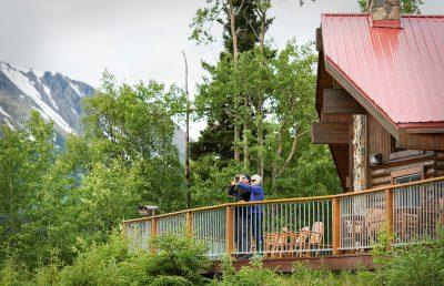 A couple on the deck of Kenai Princess Wilderness Lodge