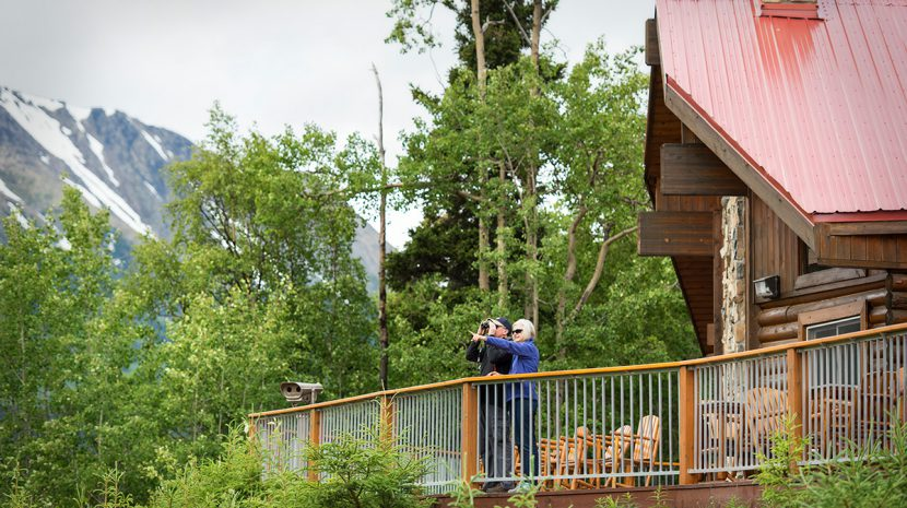 A couple on the deck of Kenai Princess Wilderness Lodge